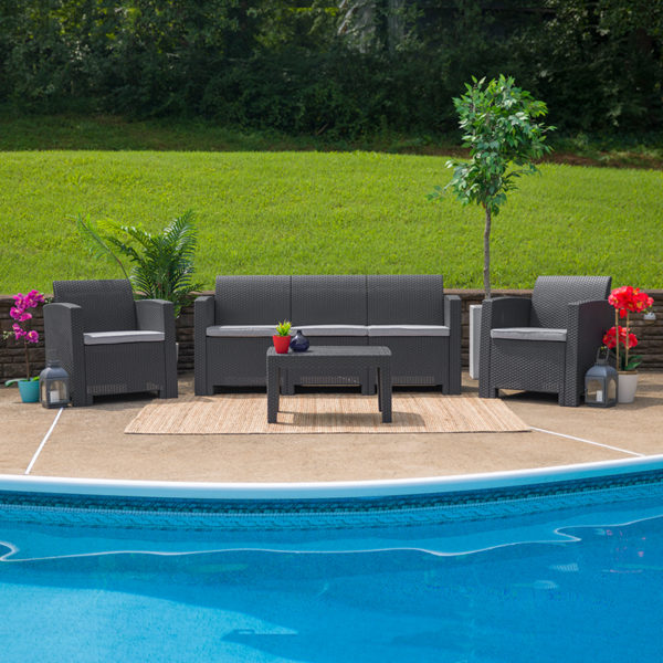 Outdoor sofa / patio couch, faux wicker/rattan, w outdoor cushion. Dark Grey.